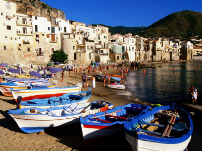 fishing-boats-on-beach-at-seaside-resort-cefalu-italy